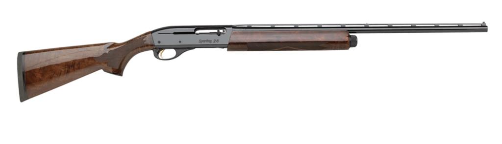 Wood-stocked semi-auto remington  model 1100 wingmaster shotgun on a white background