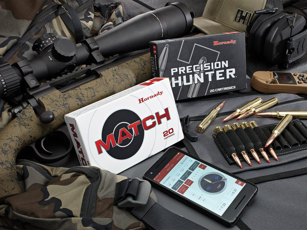 Boxes of rifle ammunition and a shooting ballistics app.
