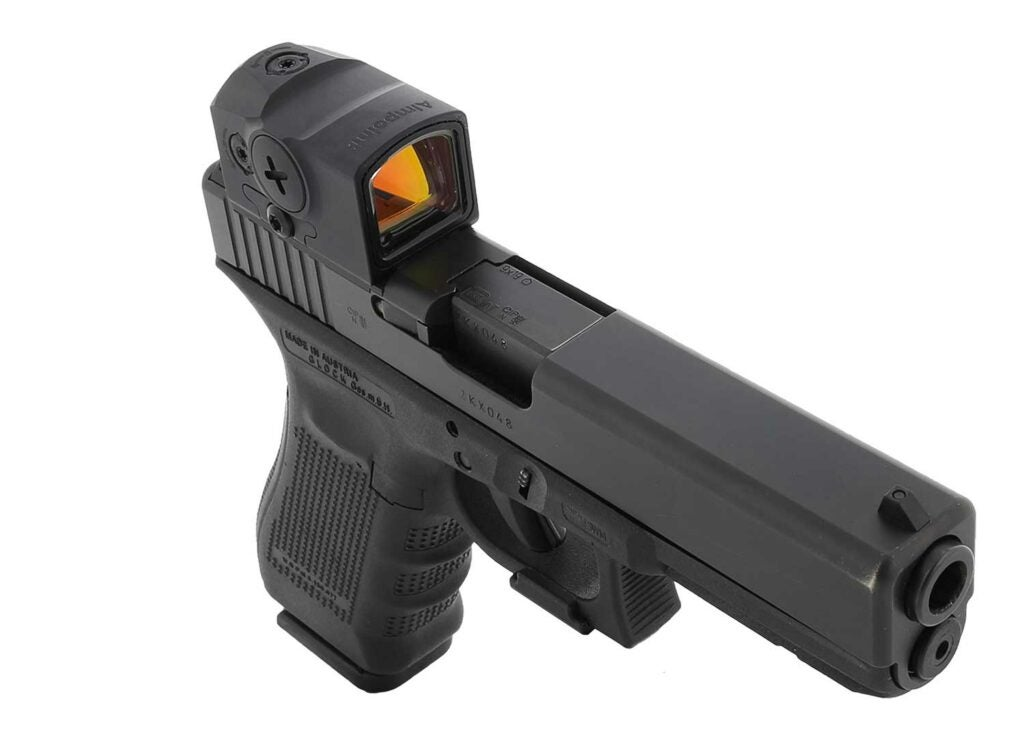 A handgun fitted with an Aimpoint red dot sight.