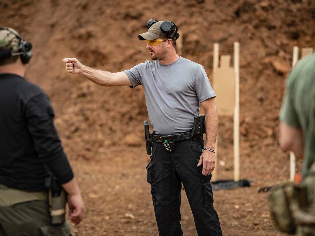 Man demonstrating the proper way to aim and grip a handgun.
