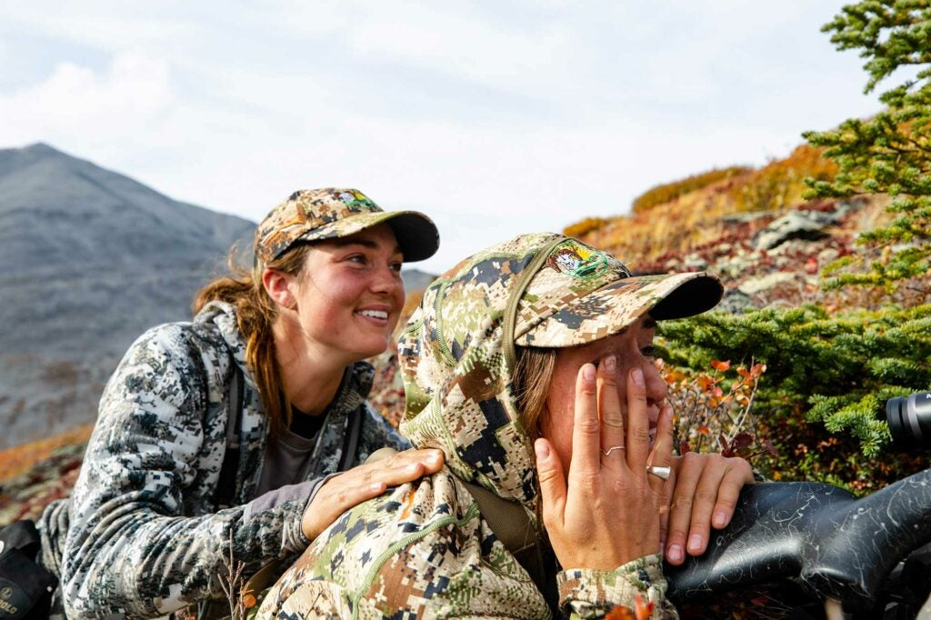 Jessie Rogers congratulates Tatum Monod after taking a Yukon caribou.