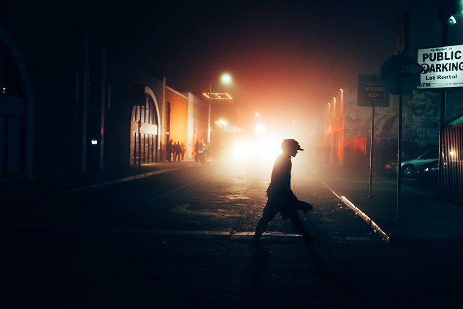 person walking in dark