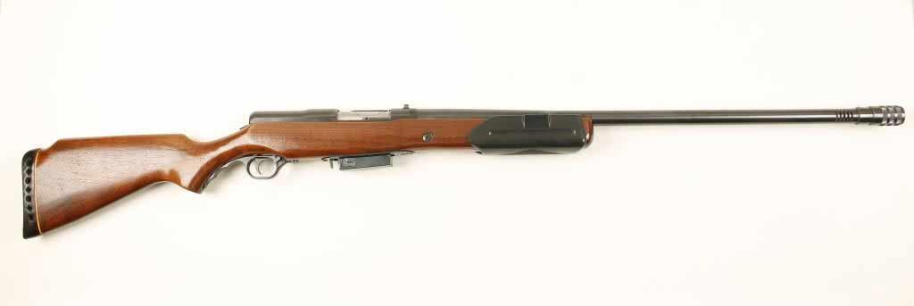 A Mossberg 200K shotgun on a white background.