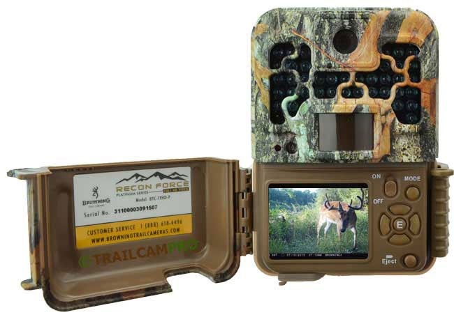 An open trail camera on a white background.