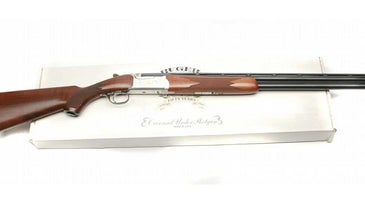 A ruger shotgun on a box on a white background.
