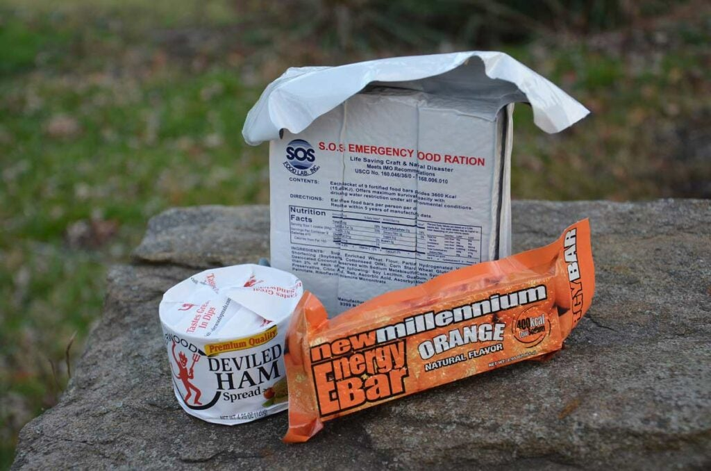 Packaged survival food on a rock.