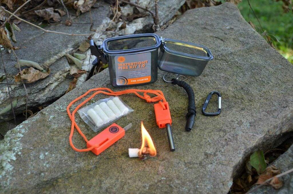 A fire-starting kit on a rock.