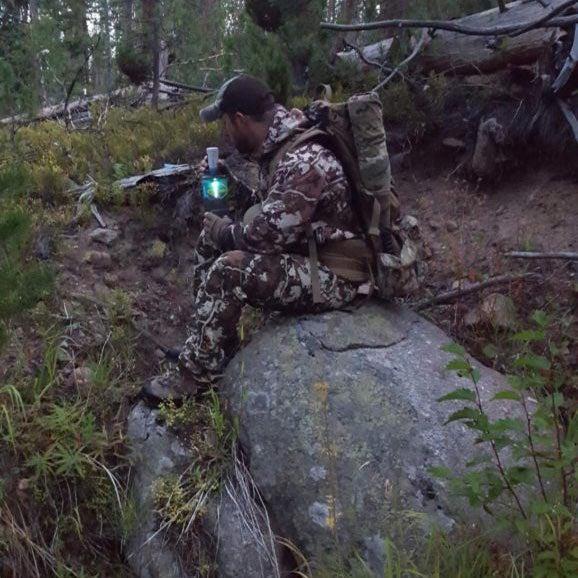 A hunter sterilyzing water.