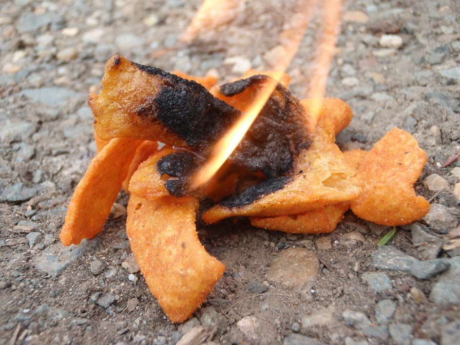 A handful of fritos on fire.