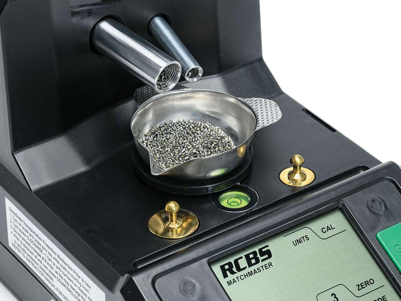Dual powder tubes mesuring reloading ammo in a bowl.
