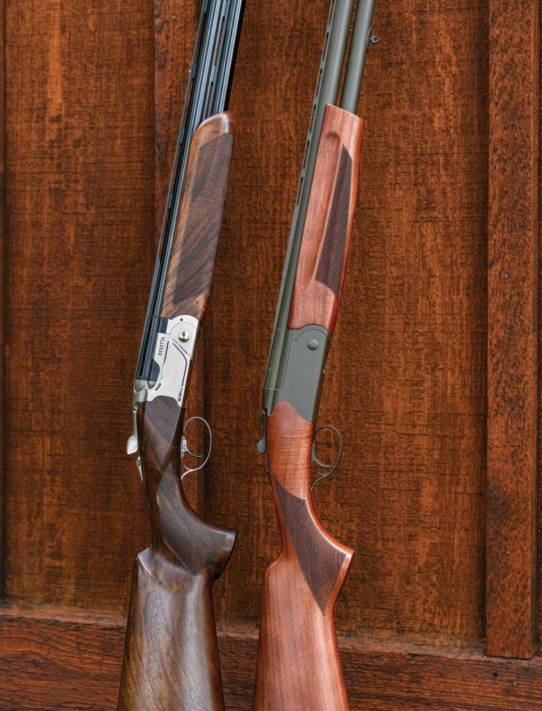 Two shotguns leaning against a wall.
