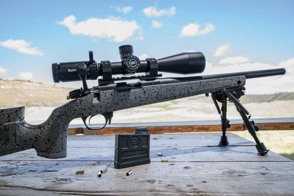A Bergara B-14R rifle resting on bipods at a shooting range.