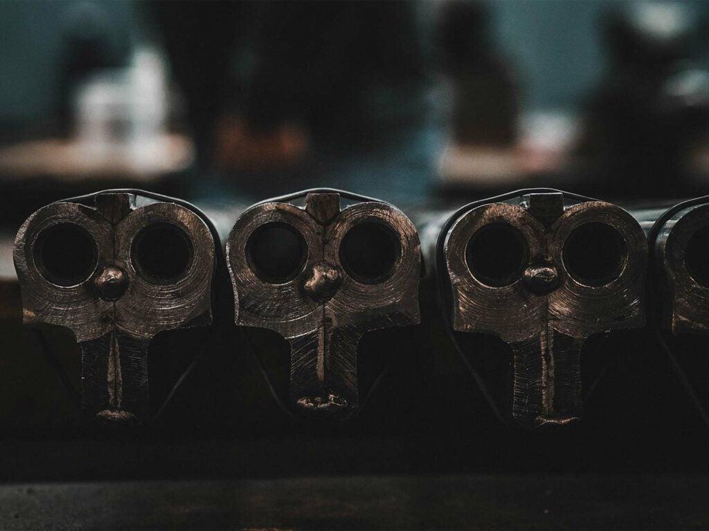 a row of AYA sidelocks in side-by-side shotguns.