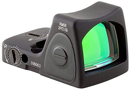 Close up detail of a Trijicon RMR on a white background.