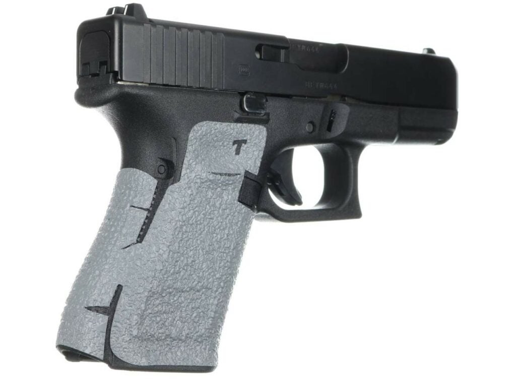 A talon grip wrapped around the handle of a handgun.