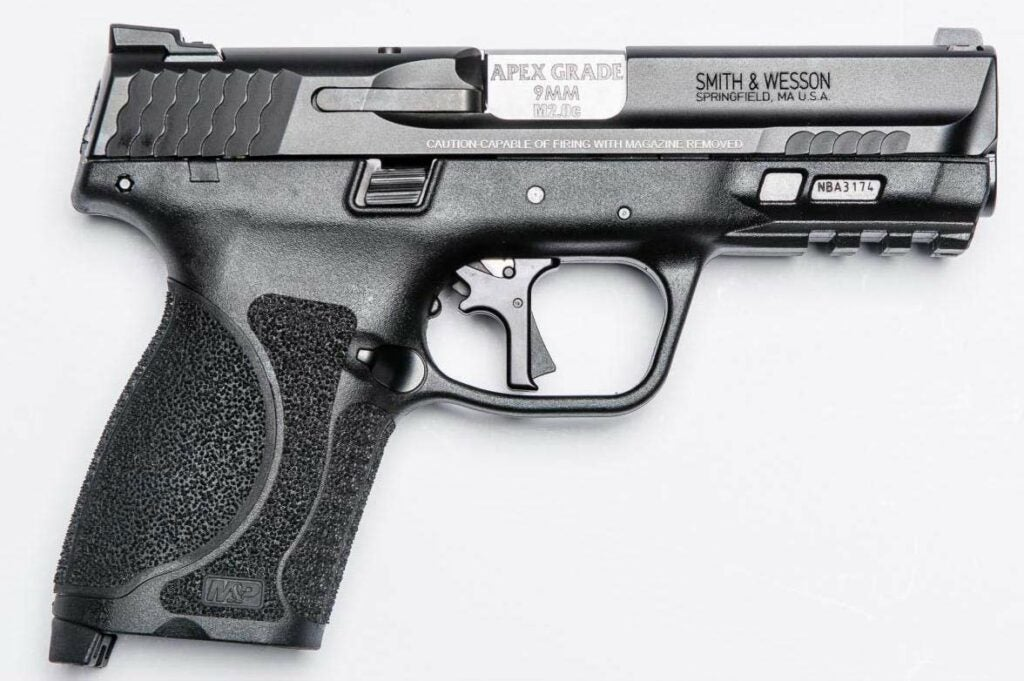 A side profile view of a smith and wesson handgun on a white background.