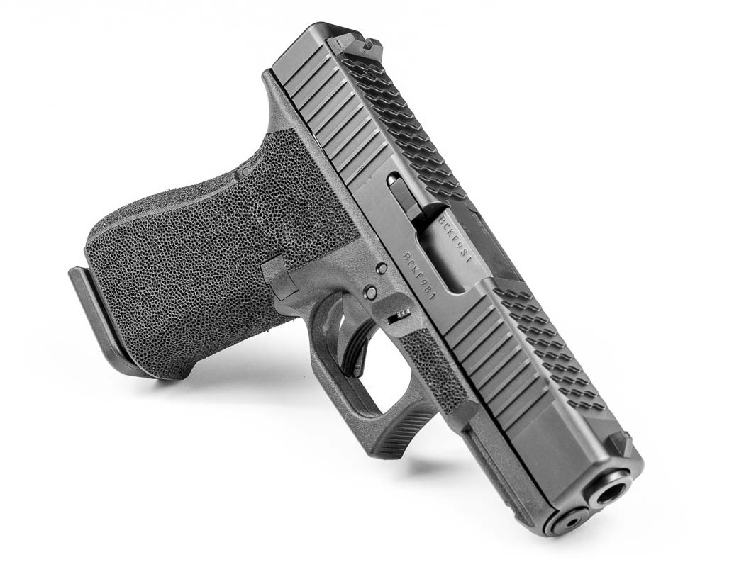 AETi rear slide serrations on a handgun.