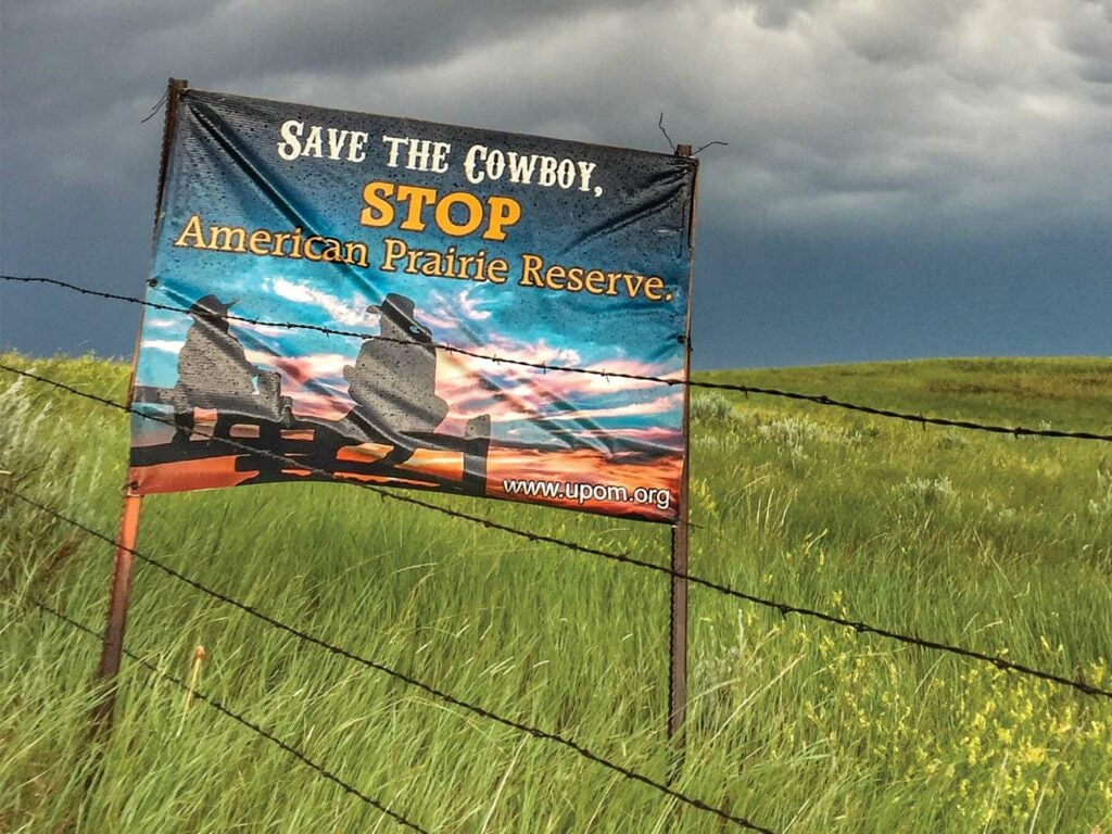 A sign that reads: Save the Cowboy, Stop American Prairie Reserve.