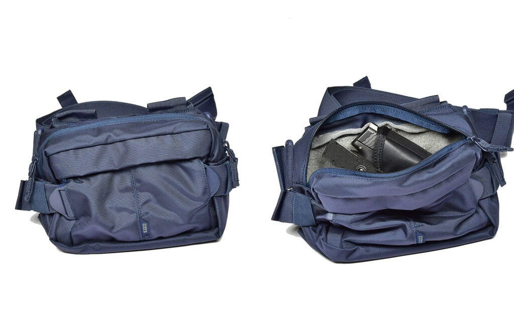 A navy blue waist pack on a white background.