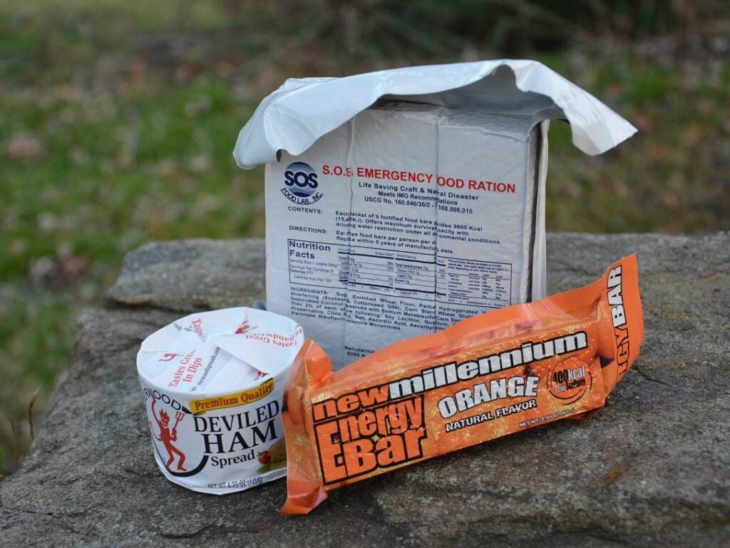 Three packages of dry goods on a rock.