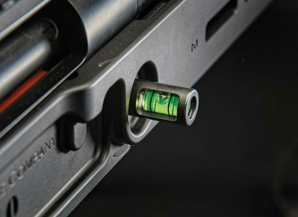 A bubble level attached to a hunting rifle stock.