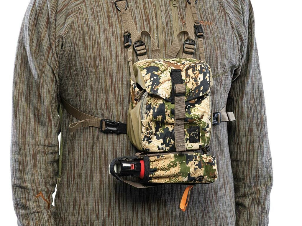 Mystery Ranch Quick Draw Bino Harness on a hunting gear model.