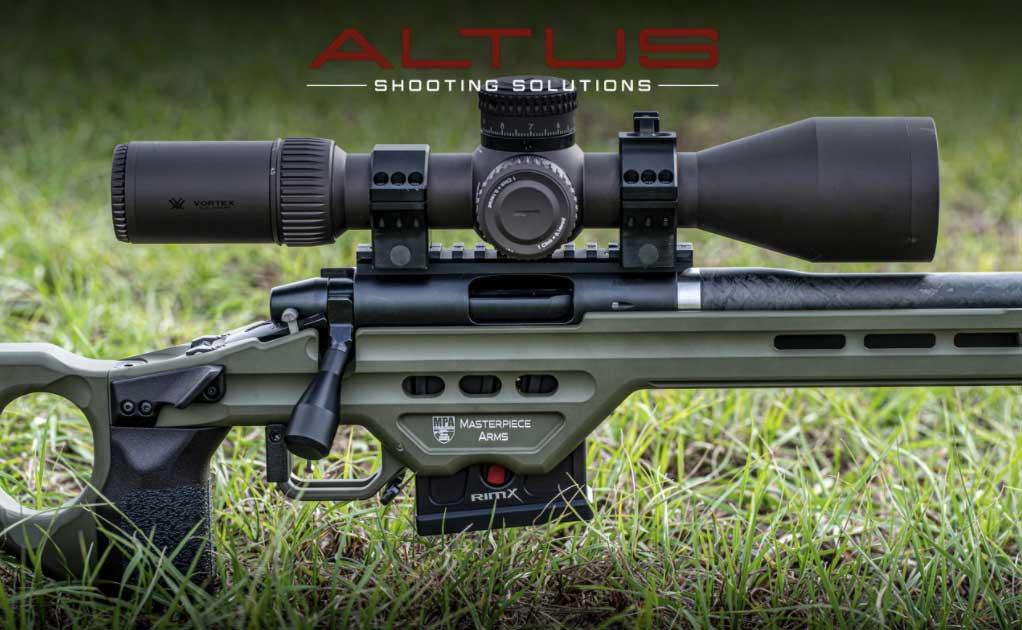 An Altus RimX rifle on a grassy ground.