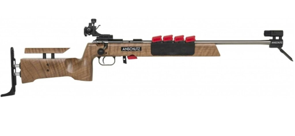 A brown and red Anshutz rimfire rifle on a white background.