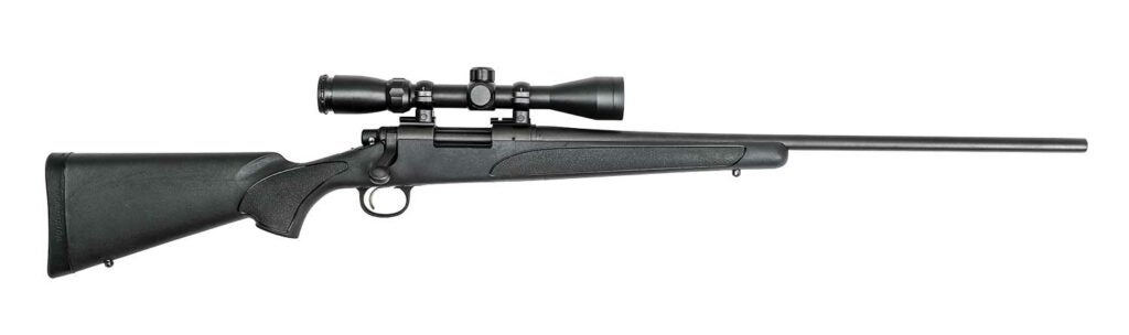 Remington Model 700 ADL Synthetic with Scope on a white background.