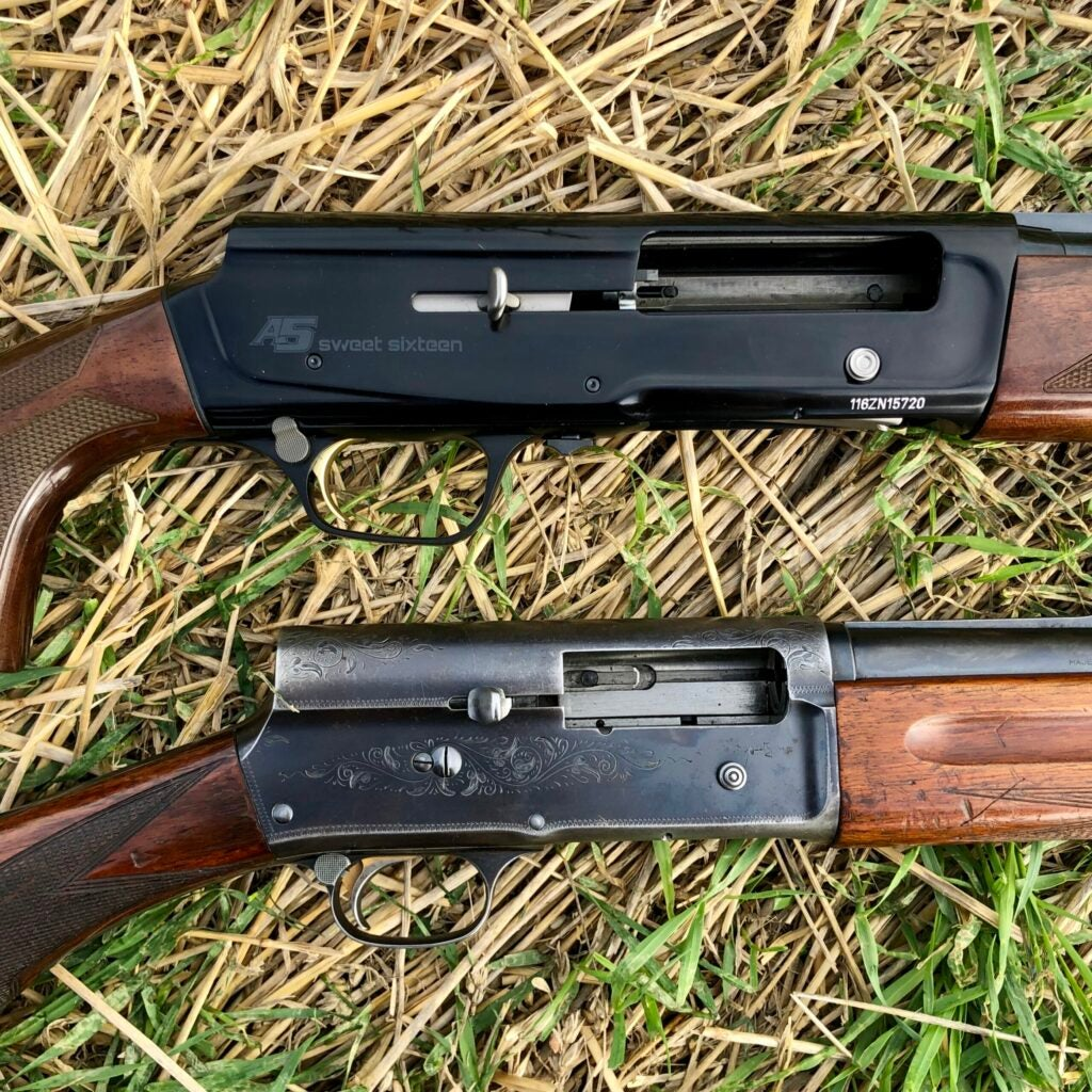 A new and an old wood-stocked semi-auto shotguns on a grass background.