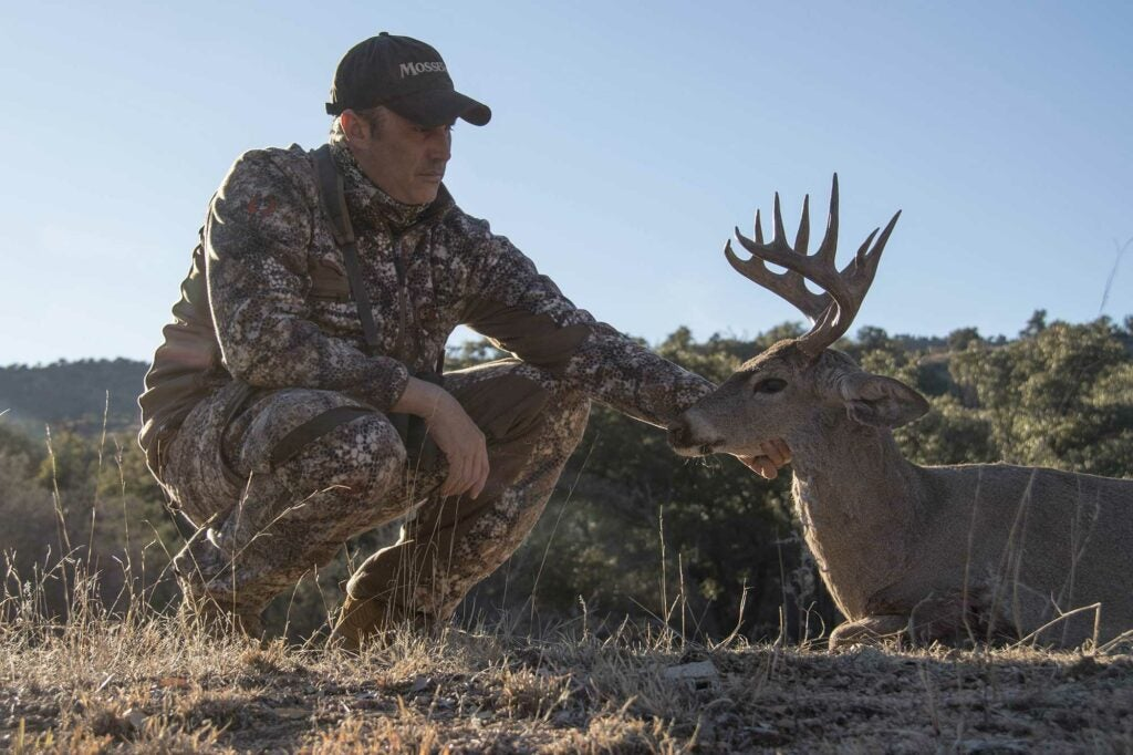 Hunter with deer