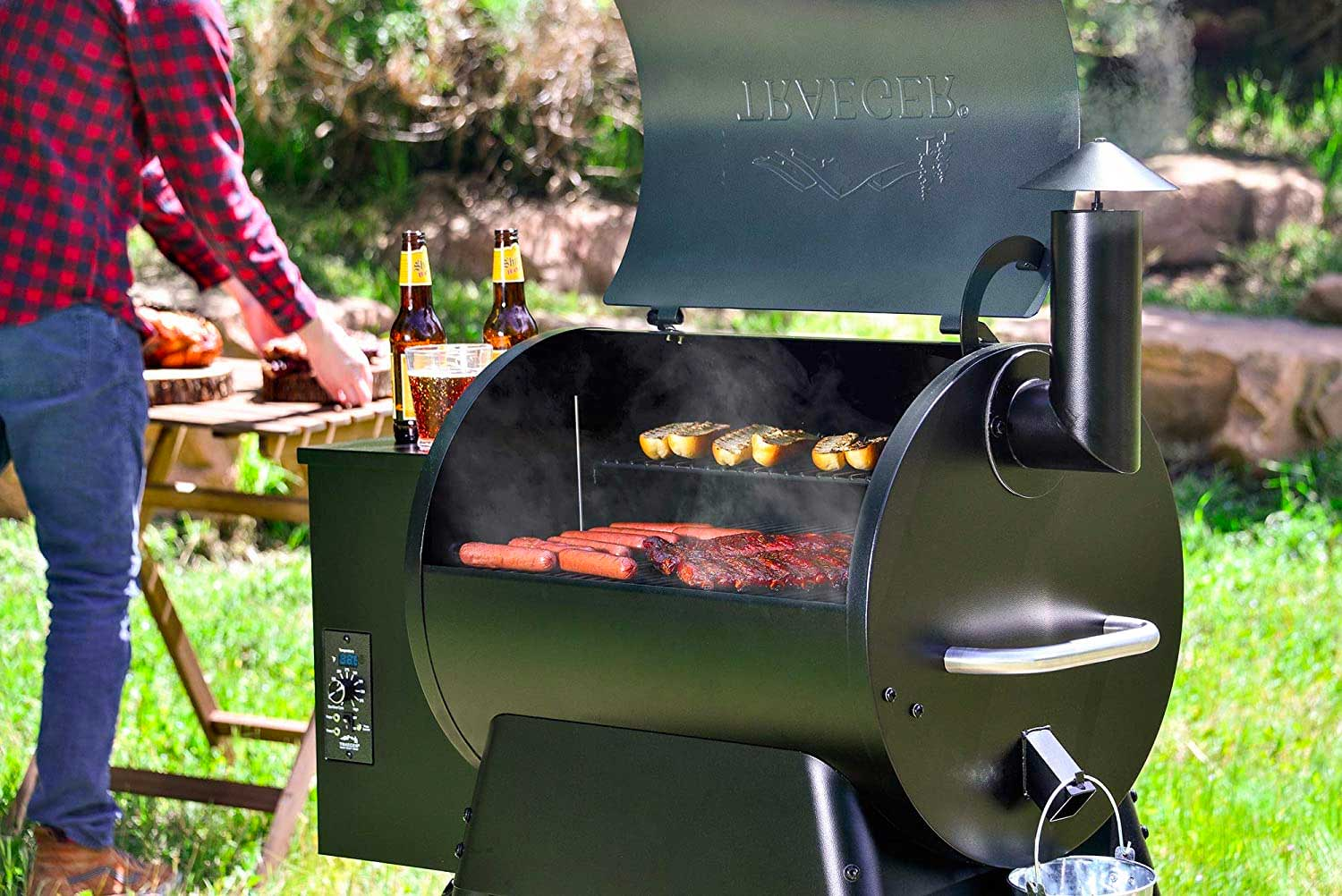 Guy grilling with a Traeger Grill Pro Series
