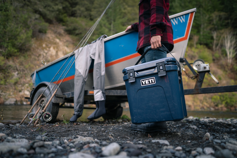 person holding a YETI cooler