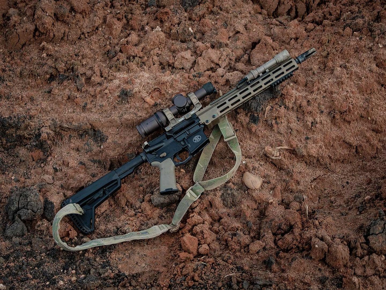 An AR rifle on the ground.