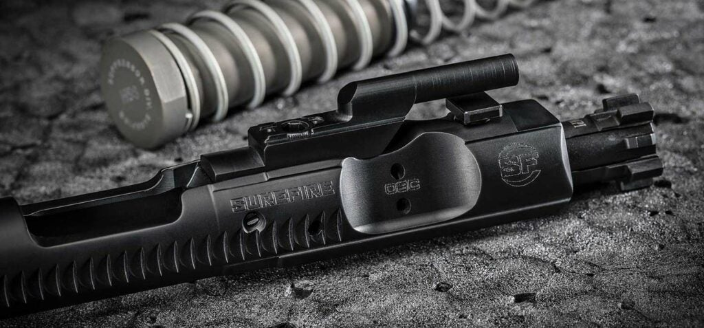Close up of a Surefire OBC bolt carrier for an AR rifle.