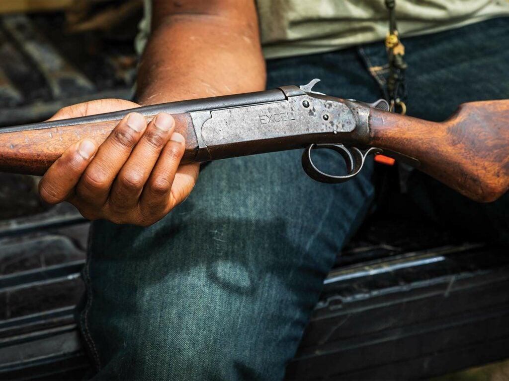 Close up of a gun in a hunters lap.