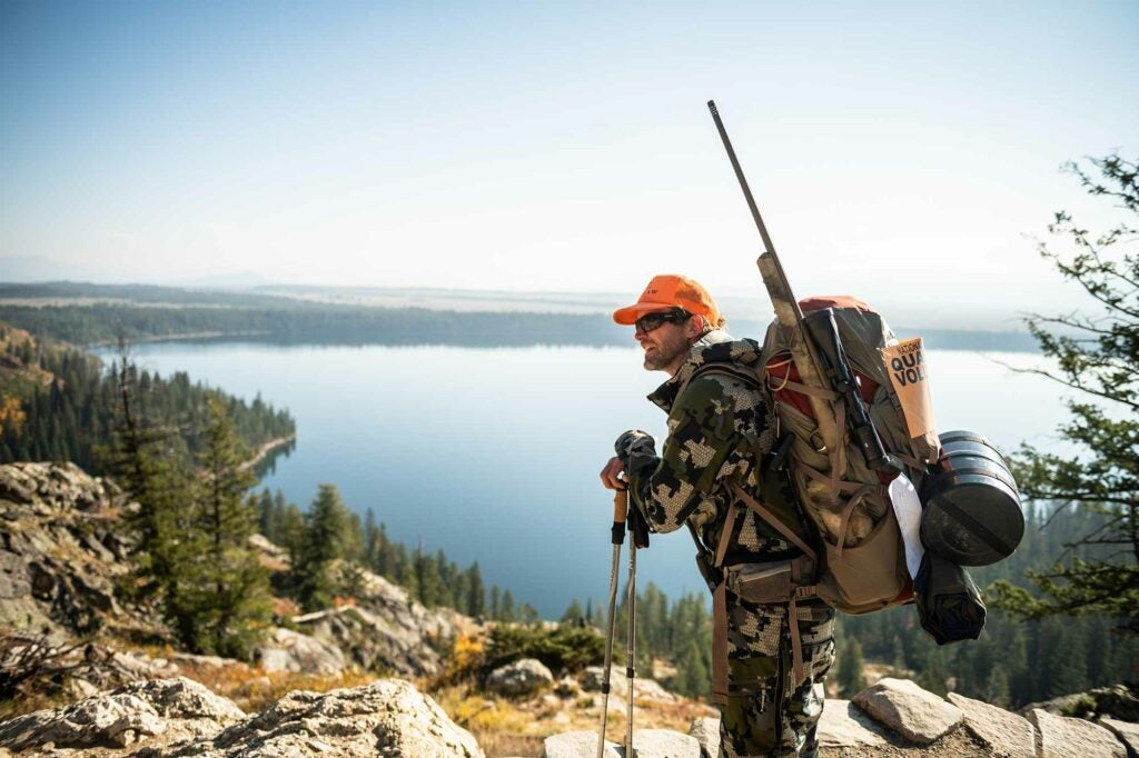 A volunteers hikes into the interior of the Grand Tetons.