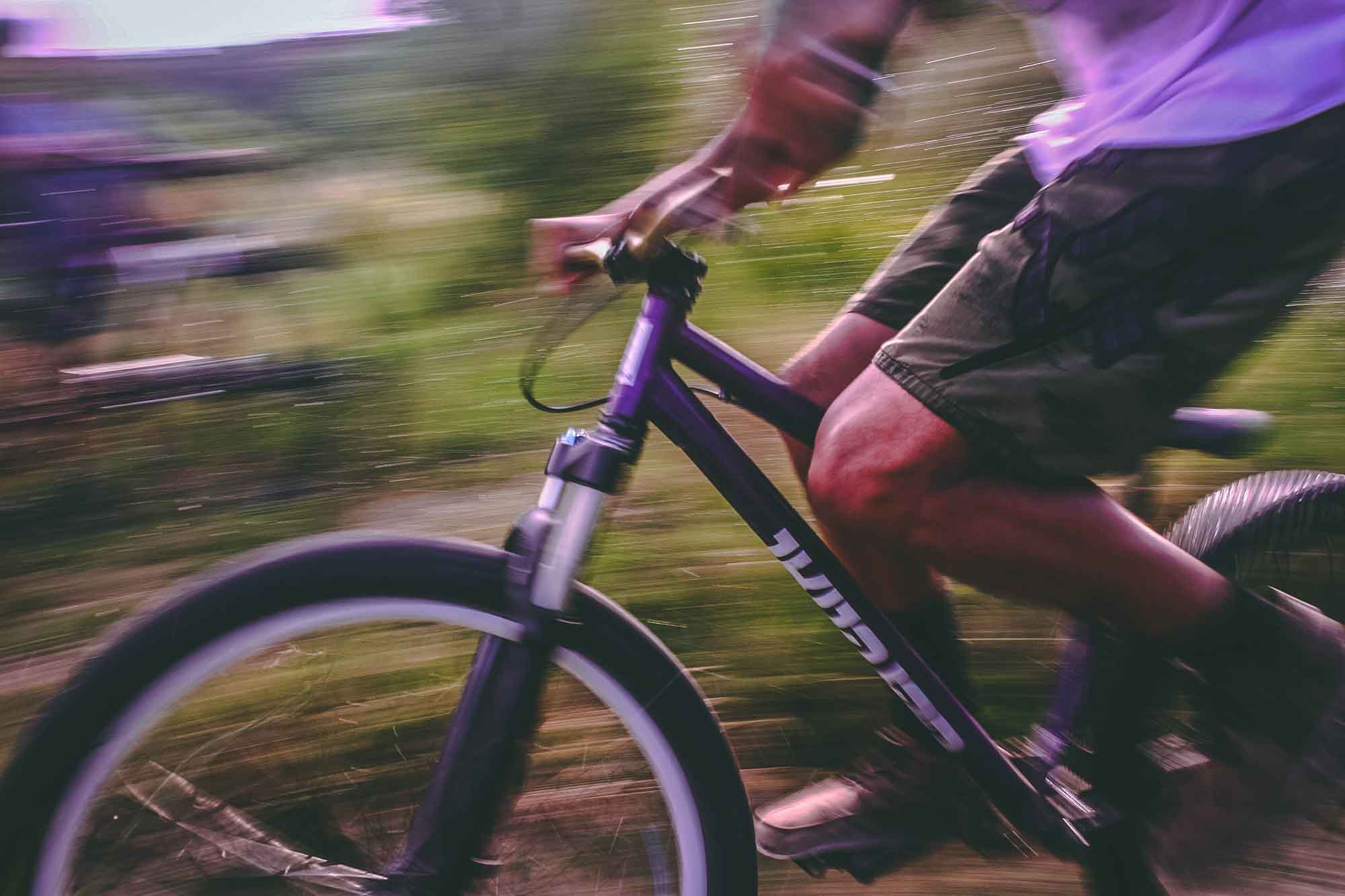 Closeup of someone riding a bicycle