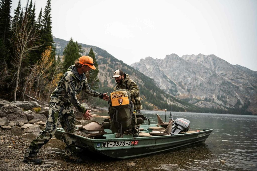 Lethal removal volunteers are all-terrain commanders. This group at Grand Teton boated in to approach remote mountain goats.