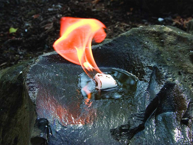 A WetFire cube in water on fire.