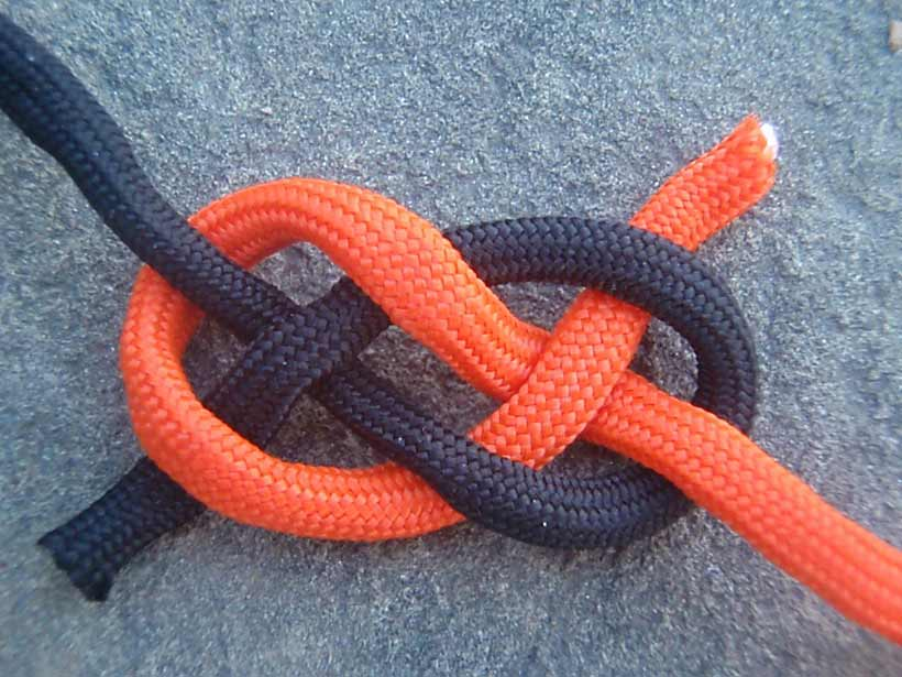 A length of orange rope tied together with a length of black rope.