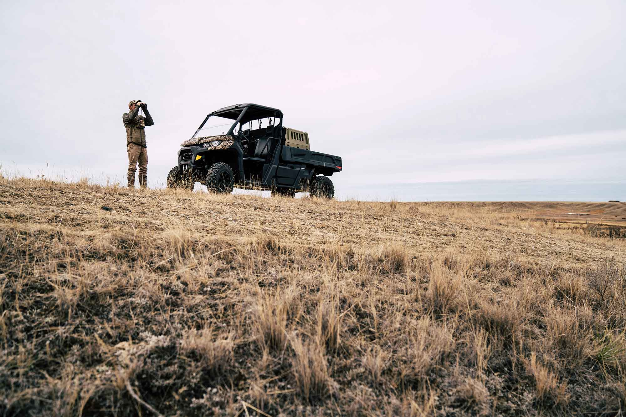 The author (Andrew McKean) glasses for deer on his home property in north-central Montana.