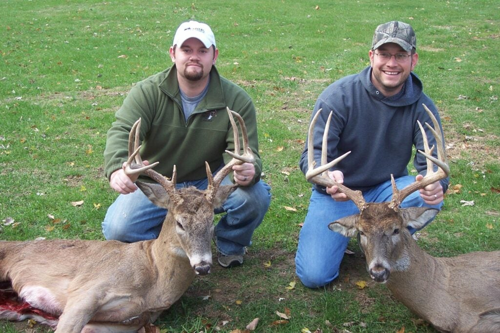 Two brothers with typical whitetail bucks.