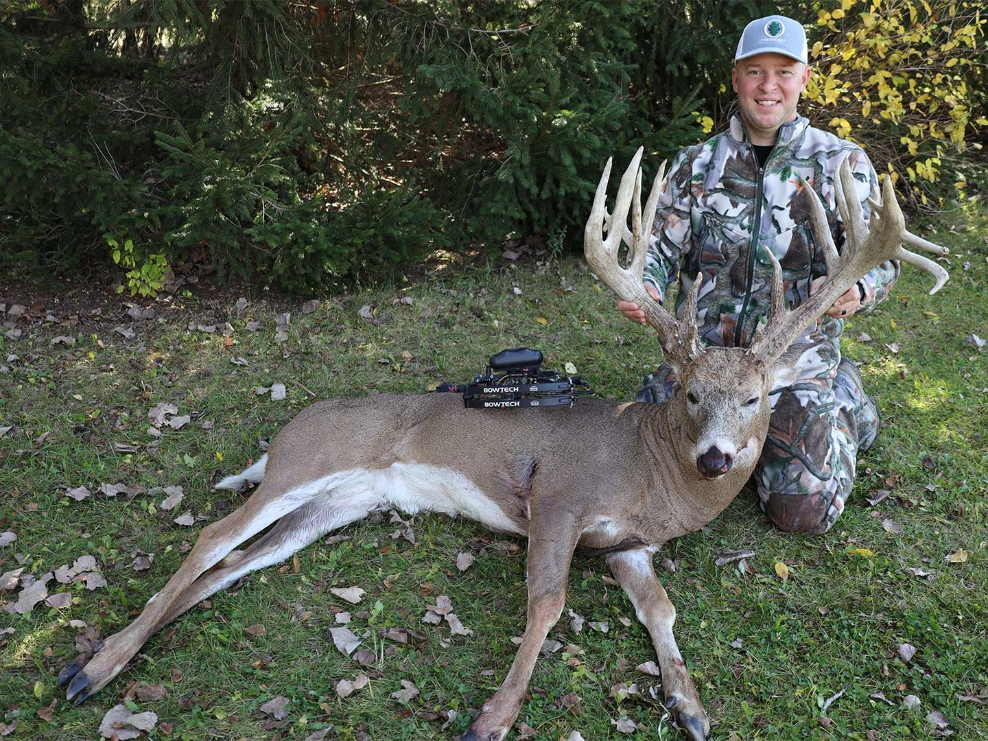 A hunter holds a whitetail deer antler.