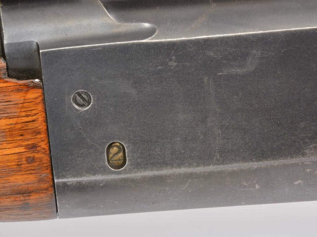 A rotary magazine indicator of remaining bullets in the side of the Savage Model 99 lever action rifle.