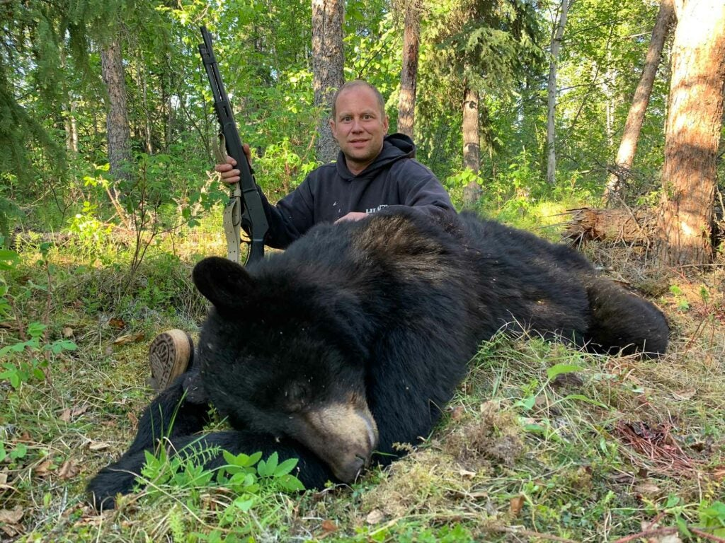 This bear was taken with a .45/70 lever gun after the boar peaked its head out from behind some cribbing.
