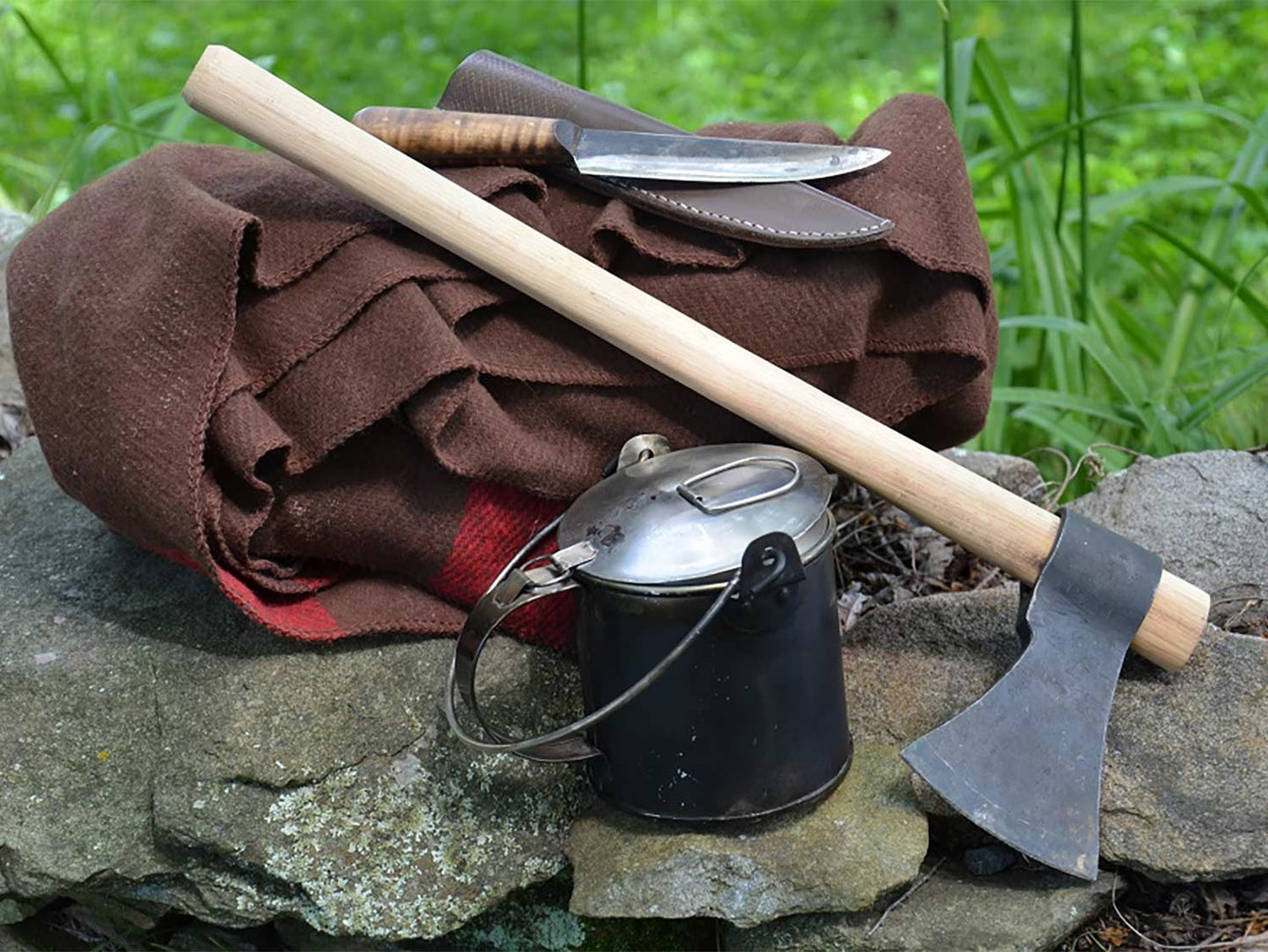 A collection of survival gear and a tomahawk.