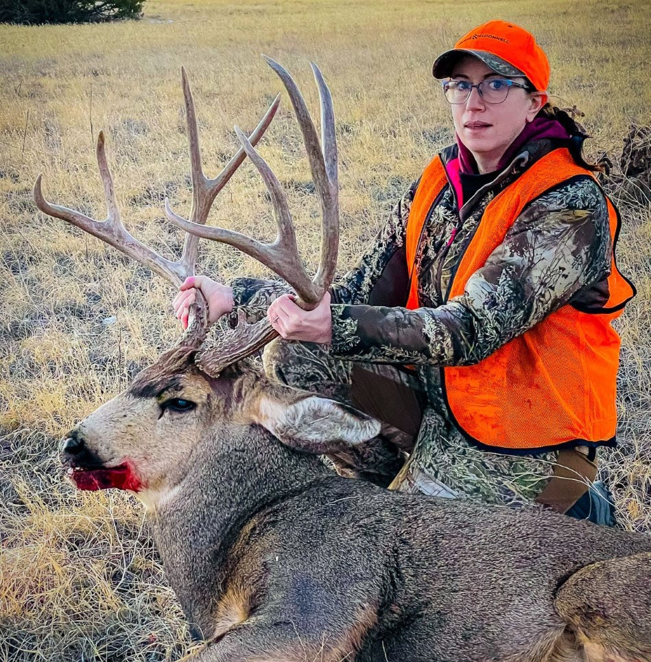 Lisa Chavez with her almost 200-inch mule deer.