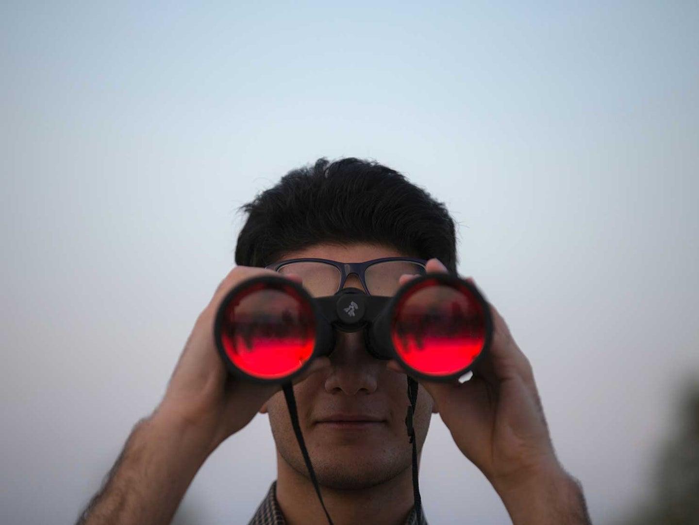 Man using binoculars.