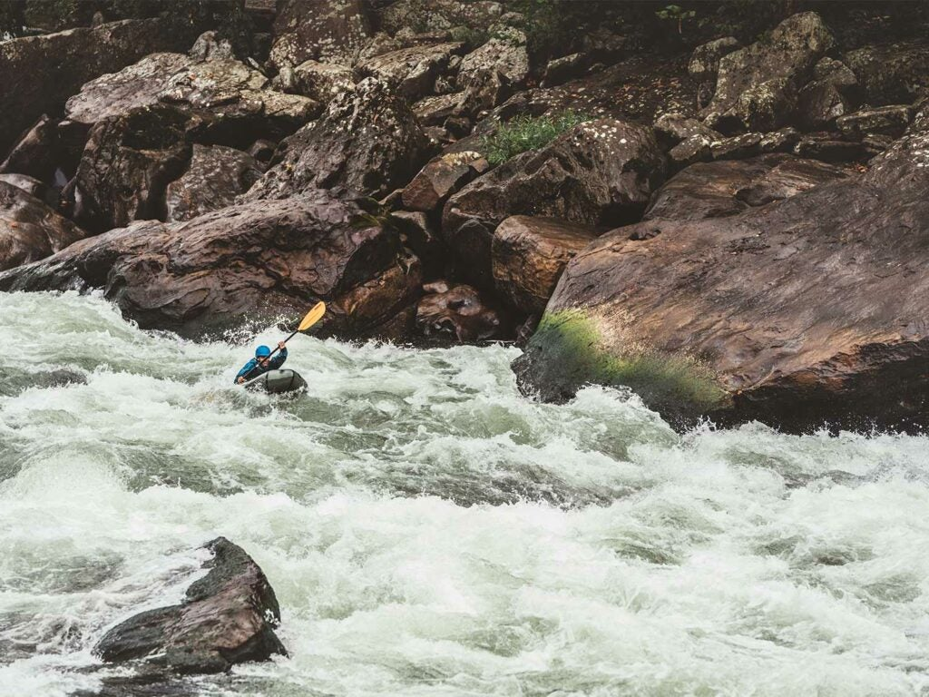 whitewater rafting down a river.